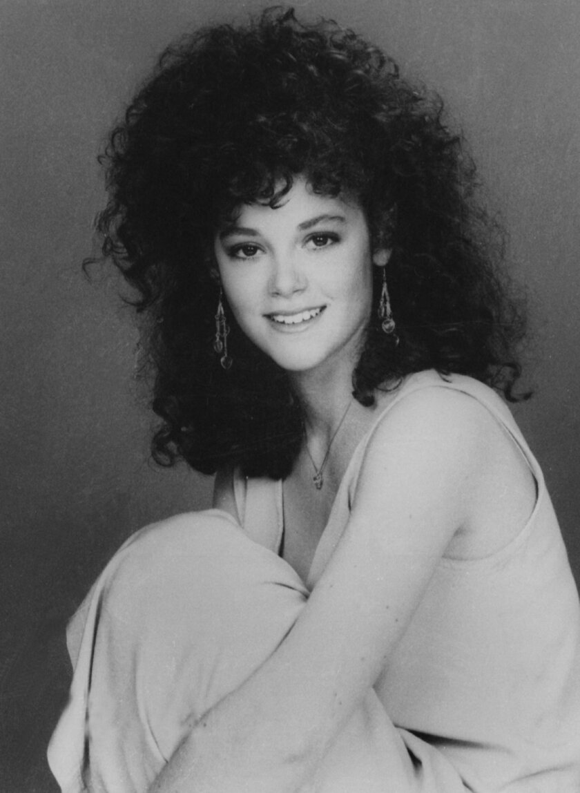 """** FILE ** In this 1987 file image, Rebecca Schaeffer, who played Patti on CBS TV's """"My Sister Sam,"""" poses in a publicity photo. The model-actress was murdered on July 19, 1989, when an obsessed fan named Robert Bardo shot and killed her at the door of her Los Angeles apartment. Schaeffer's death prompted reforms that made stalking a crime, prevented the Department of Motor Vehicles from releasing home addresses, and the creation of a specialized police unit to protect celebrities and dignitaries. (AP Photo/CBS, file)"""