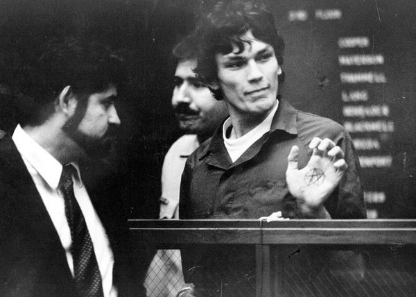 Richard Ramirez with palm inked with star symbol in court in 1985.