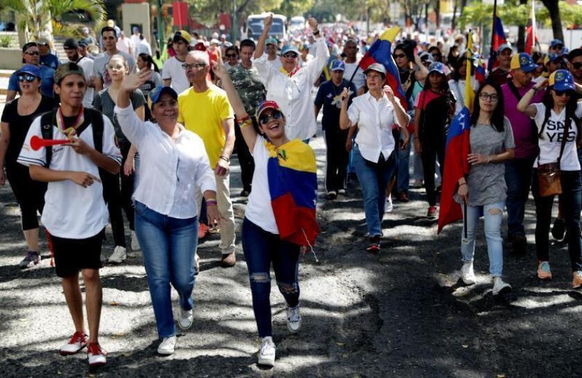Protesters prepare to take part in a mass rally on Feb. 2, 2019, in Caracas, Venezuela, against leftist President Nicolas Maduro's administration. EPA-EFE/Leonardo Muñoz