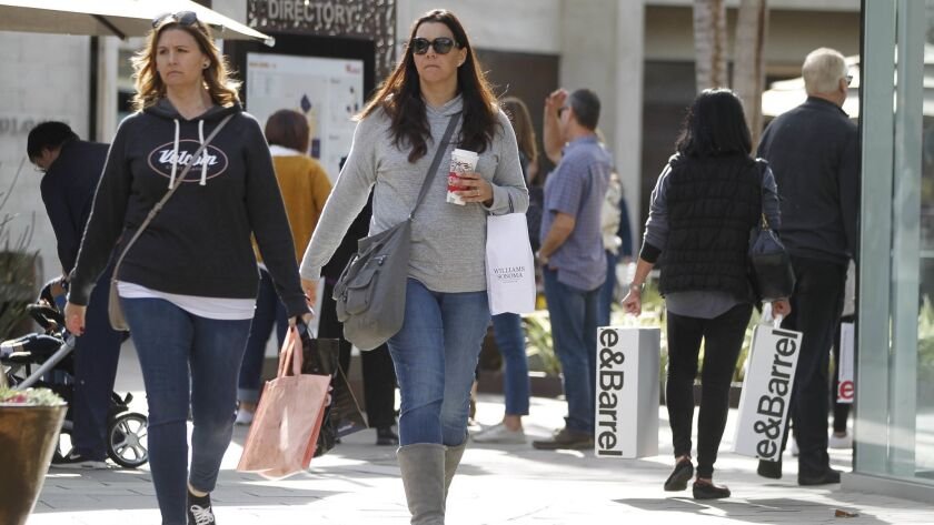 SAN DIEGO, December 23, 2017 | People shop at the Westfield UTC shopping mall in San Diego on Saturd