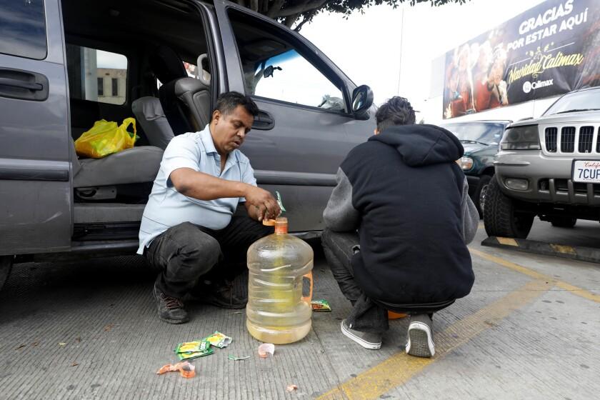 TIJUANA, BAJA CALIF. -- WEDNESDAY, NOVEMBER 28, 2018: Irineo Mujica, left, a leader with Pueblo Sin