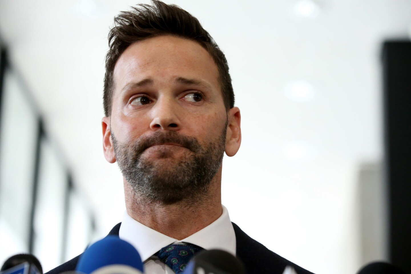 Former U.S. Rep. Aaron Schock appears March 6, 2019 after his scheduled hearing at the U.S. Dirksen Courthouse in Chicago. Federal prosecutors have agreed to drop all charges against him if he pays back money he owes to the Internal Revenue Service and his campaign fund.