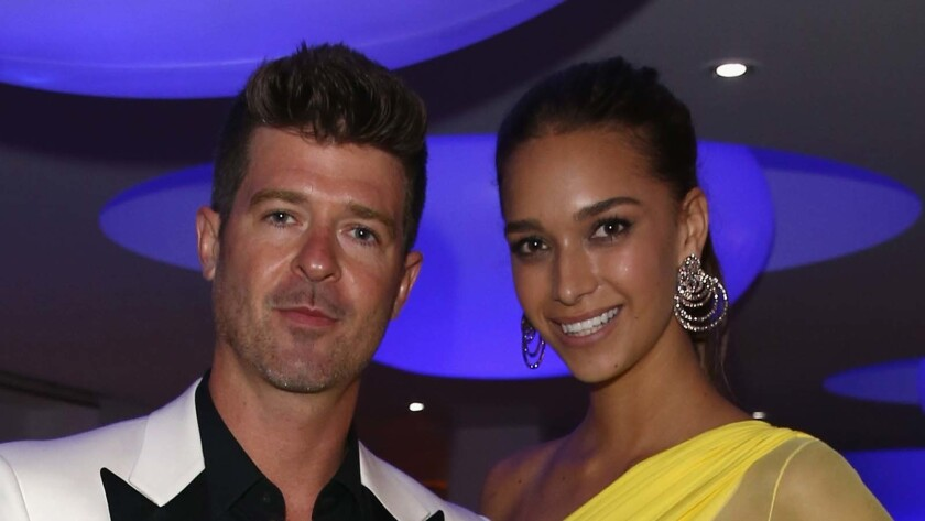 Robin Thicke and April Love Geary.