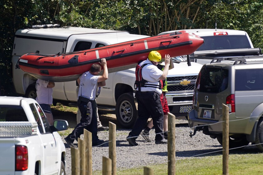 FILE - In this June 18, 2021 file photo, rescue personnel stage along the Dan River in Eden, N.C. One of four survivors of a deadly tubing accident said by the time her family saw the dam on the Dan River, it was too late. (AP Photo/Gerry Broome, File)
