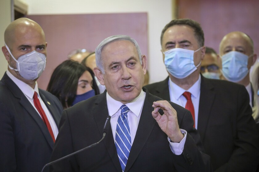 Israeli Prime Minister Benjamin Netanyahu delivers a statement before entering the district court in Jerusalem in May.