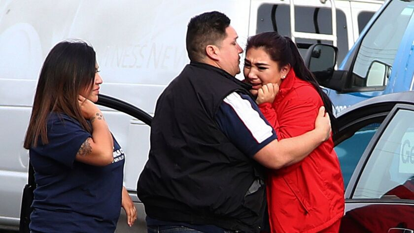Fernando Juarez, 36, of Napa, embraces his sister Vanessa Flores, 22, at the Veterans Home of California in Yountville. Flores, a caregiver at the facility, exchanged texts with family while sheltering in place.