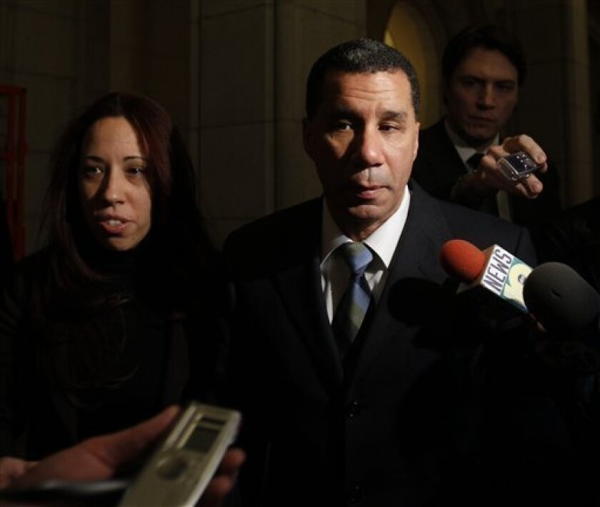 New York Gov. David Paterson talks to reporters as he leaves the Capitol in Albany, N.Y., on Tuesday, March 2, 2010. (AP Photo/Mike Groll)