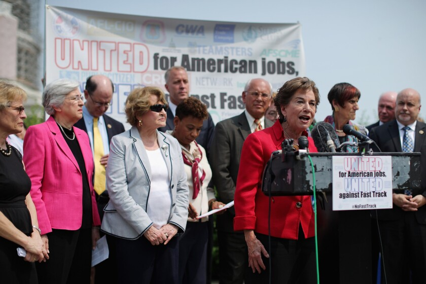 Rep. Jan Schakowsky (D-Ill.) and fellow Democratic members of Congress voice their opposition to the Trans-Pacific Partnership trade deal at the U.S. Capitol.