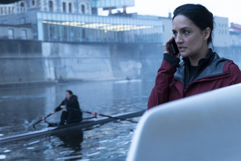 "This image released by Peacock shows Archie Panjabi as Kendra Malley in a scene from ""Departure."" Panjabi plays an aviation investigator and single mom who is called in to solve the strange disappearance of a jetliner en route to London in the six-part series premiering on Sept. 17 on the Peacock streaming platform. (Stephen Scott/Shaftesbury/Greenpoint Productions/Peacock via AP)"