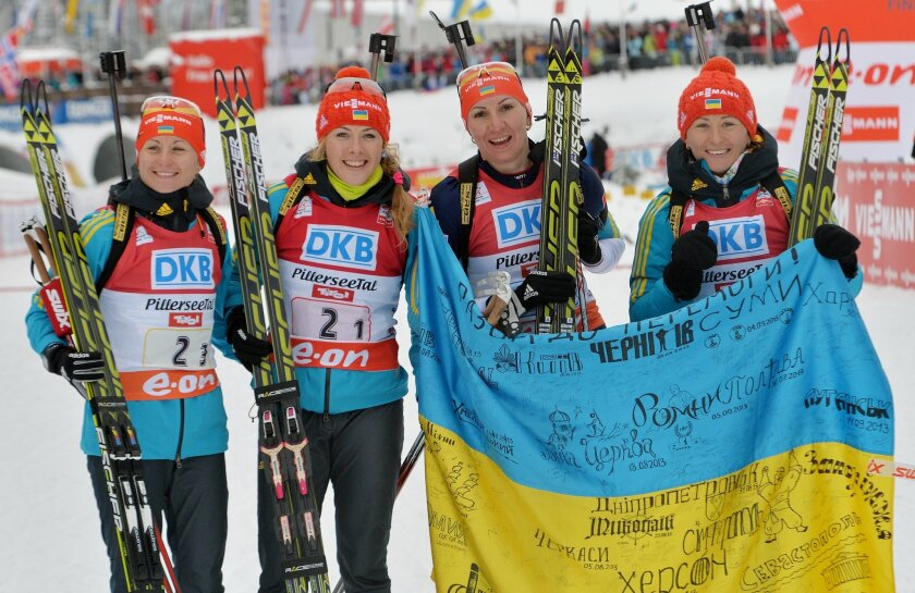 Ukraine's Valj Semerenko, Juliya Dzhyma, Olena Pidhrushna and Vita Semerenko, from left, pose for the media after they won the women's Biathlon World Cup 4x6 kilometers relay in Hochfilzen, Austria, on Saturday, Dec. 7, 2013. (AP Photo/Kerstin Joensson)