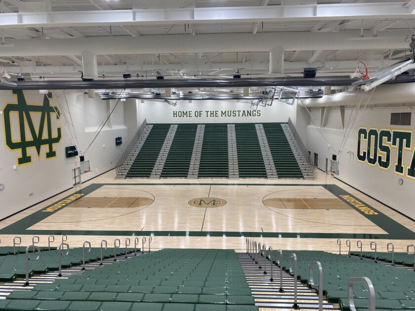 """""""Home of the Mustangs"""" is painted in Mira Costa's new gym"""