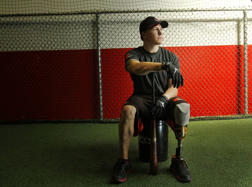 """Navy Hospital Corpsman 3rd Class Daniel """"Doc"""" Jacobs, who lost part of his leg in a 2006 bombing in Iraq will try our for several major league baseball teams this spring training."""