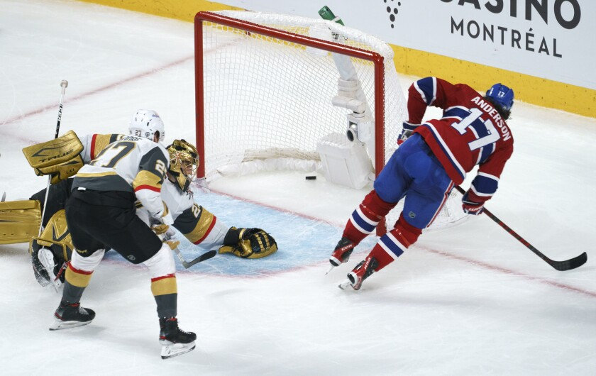 Montreal Canadiens' Josh Anderson scores past Vegas Golden Knights goaltender Marc-Andre Fleury during overtime in Game 3 of an NHL hockey semifinal series, Friday, June 18, 2021, in Montreal. (Paul Chiasson/The Canadian Press via AP)