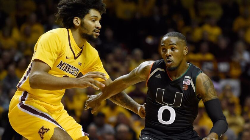Miami's Ja'Quan Newton (0) drives to the basket against Minnesota's Jordan Murphy (3) during the first half on Wednesday.