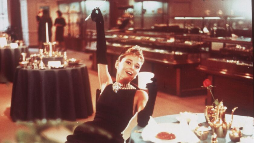"Audrey Hepburn in the 1961 romantic comedy ""Breakfast at Tiffany's."" Hepburn's sons are battling over a charity's use of her likeness, gowns and other items, according to a lawsuit filed in Los Angeles County Superior Court."