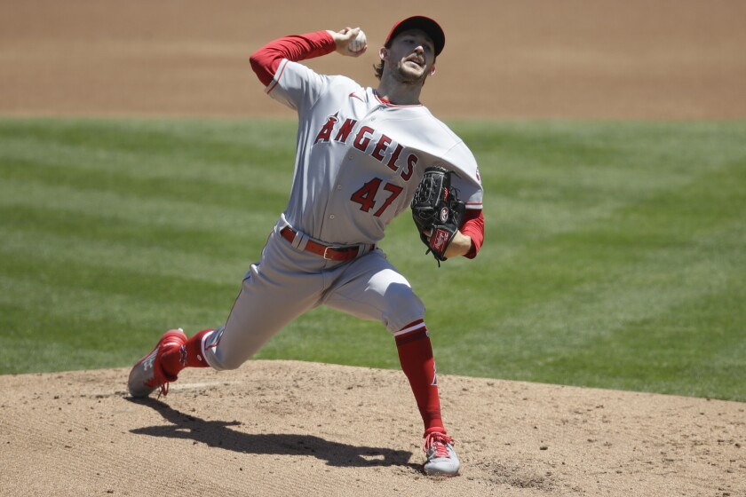 Angels pitcher Griffin Canning works against the Oakland Athletics in the first inning on Monday in Oakland.