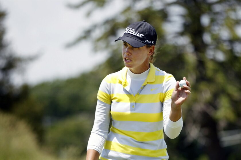 Karine Icher, of France, holds up her ball on the ninth hole of the second round of the ShopRite LPGA Classic golf tournament, Saturday, June 4, 2016, in Galloway Township, N.J.(AP Photo/Mel Evans)