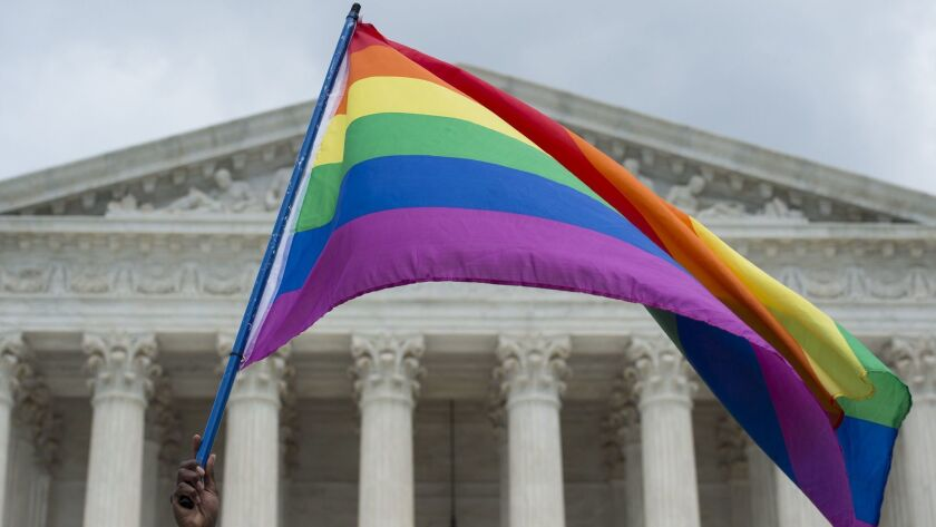 A rainbow flag is flown outside the Supreme Court in Washington, DC on June 26, 2015 after it ruled that gay marriage is a nationwide right.