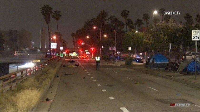 Victim killed in downtown L A  motorcycle chase was homeless man