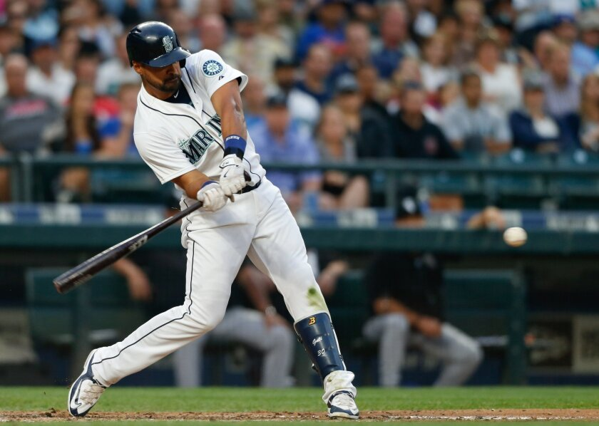Seattle Mariners' Franklin Gutierrez hits a two RBI double against the Chicago White Sox during the sixth inning of a baseball game on Saturday, Aug. 22, 2015, in Seattle. (AP Photo/John Froschauer)