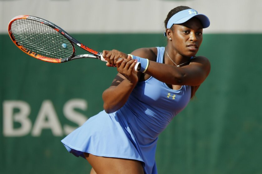 Sloane Stephens of the U.S. returns in her third round match of the French Open tennis tournament against Bulgaria's Tsvetana Pironkova at the Roland Garros stadium in Paris, France, Friday, May 27, 2016. (AP Photo/Alastair Grant)