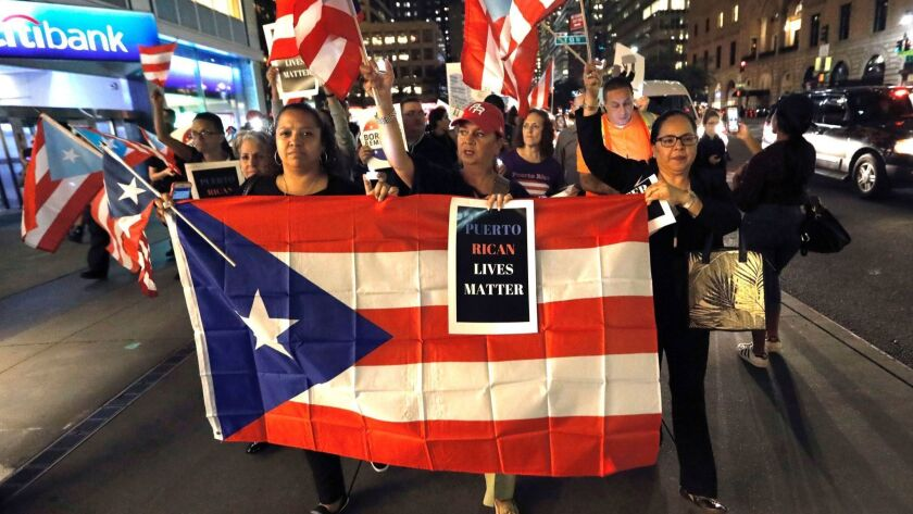 Protest march and memorial service for first annivesary of Hurricane Maria, New York, USA - 20 Sep 2018