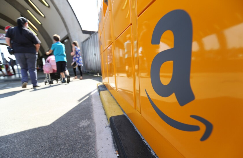 The Amazon logo; Amazon says $9.99 e-books will sell more. Will they?