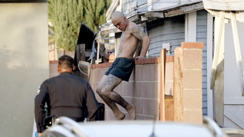 A man being chased by police is taken into custody in the 1900 block of Keeler Street in Burbank.