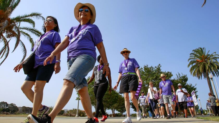 Cancer survivors walk the first lap of the American Cancer Society's Relay For Life, a two-day team fundraising event at Liberty Station in San Diego.