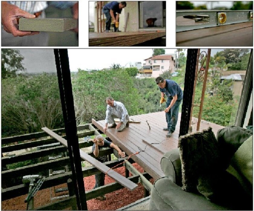 Contractor Patrick Rogers (center) and crew members Nick Wood (left) and Ramon Webb built a deck at a Pacific Beach home using LifeTime Lumber, a wood-substitute product containing fly ash and polyurethane.