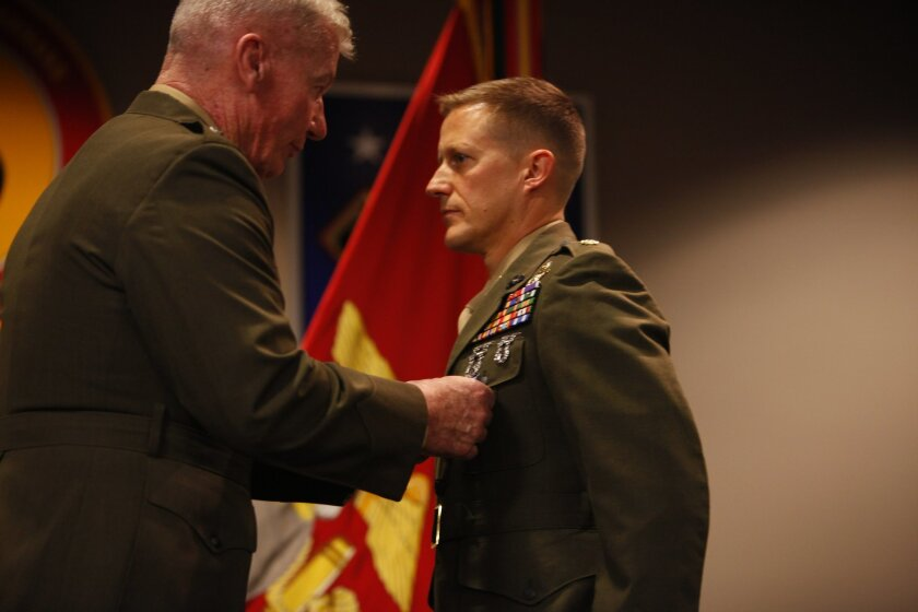 Lt. Gen. John A. Toolan, left, pins the Silver Star on the lapel of Maj. Robb T. McDonald.