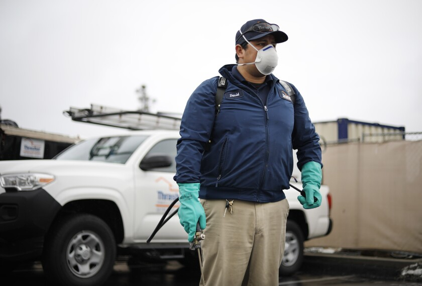 David Aguirre is an exterminator for Thrasher Termite & Pest Control in Kearney Mesa. Aguirre is among the thousands of workers deemed essential by the state.