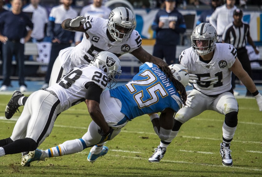 Chargers running back Melvin Gordon is brought down by Oakland Raiders free safety Lamarcus Joyner.