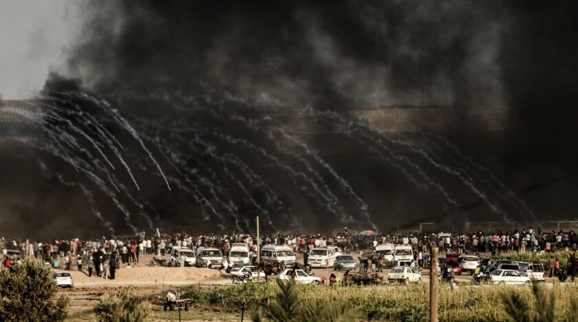 Israeli forces fire tear gas at demonstrators east of Gaza City along the border between the Gaza Strip and Israel on June 29.