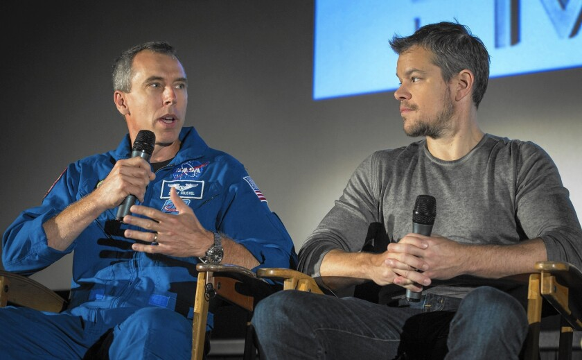 """Astronaut Drew Feustel, left, speaks as actor Matt Damon listens during a question-and-answer session about NASA's journey to Mars and the film """"The Martian."""""""
