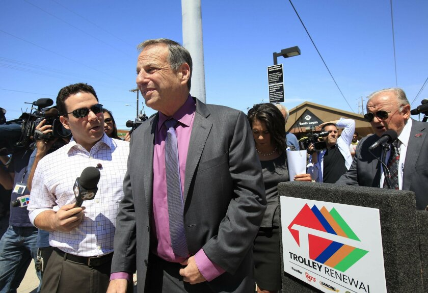 10News reporter Mitch Blacher tries to get answers out of Mayor Bob Filner about his trip to France.