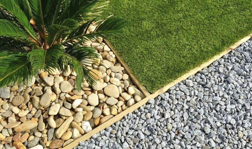 Consider reducing the size of your lawn by creating a grass-free border with rock, mulch or low-water plants.