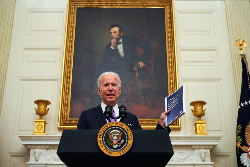 President Biden talks Thursday at the White House about his plan for addressing COVID-19.