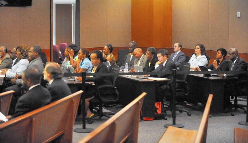 Defendants in a school cheating case and their attorneys listen during a hearing in Fulton County Superior Court this month. Twelve former Atlanta Public Schools employees are accused of boosting students' scores by altering answers in standardized tests.