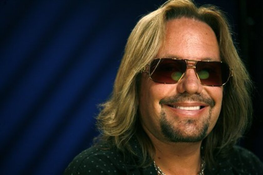 A June 26, 2010 file photo shows Vince Neil as he poses for a portrait in New York. The Las Vegas Sun reports that the 49-year-old Motley Crue singer's DUI case will now be heard by a newly elected judge who is assigned to DUI trials on Jan. 26, 2011. (AP Photo/Jeff Christensen/file)