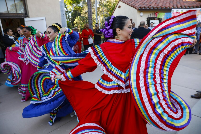 Ballet folkloric performs during the House of Mexico cottage 's long awaited grand opening.