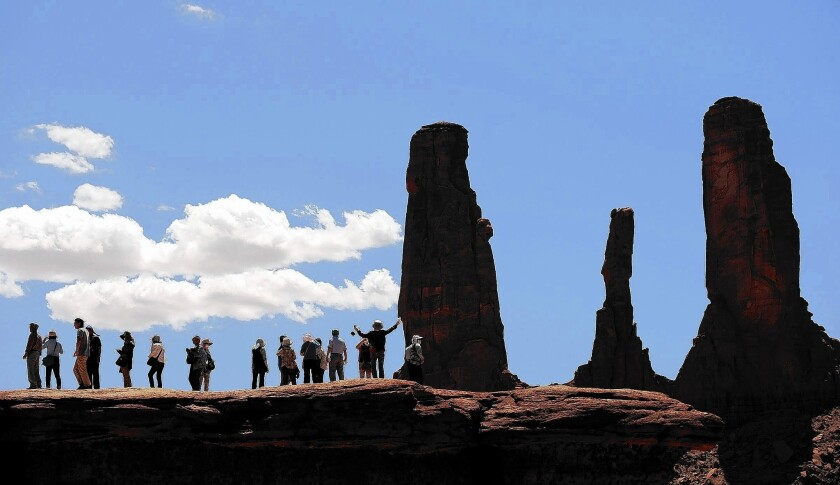 Tourists take pictures in Monument Valley on the Arizona-Utah border.