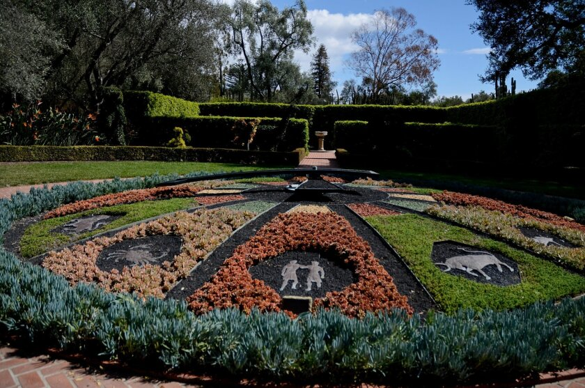 This Saturday, Feb. 28, 2015 photo shows a working horticultural clock that was installed in 1955 in the Topiary Garden at Lotusland, in Montecito, Calif. Although the plantings and decorations have changed many times over the years, it now has three different succulent varieties surrounding zodiac signs and is encircled by a fourth low-growing succulent, Senecio mandraliscae. Lotusland is open from mid-February through mid-November. (AP Photo/Pamela Hassell)