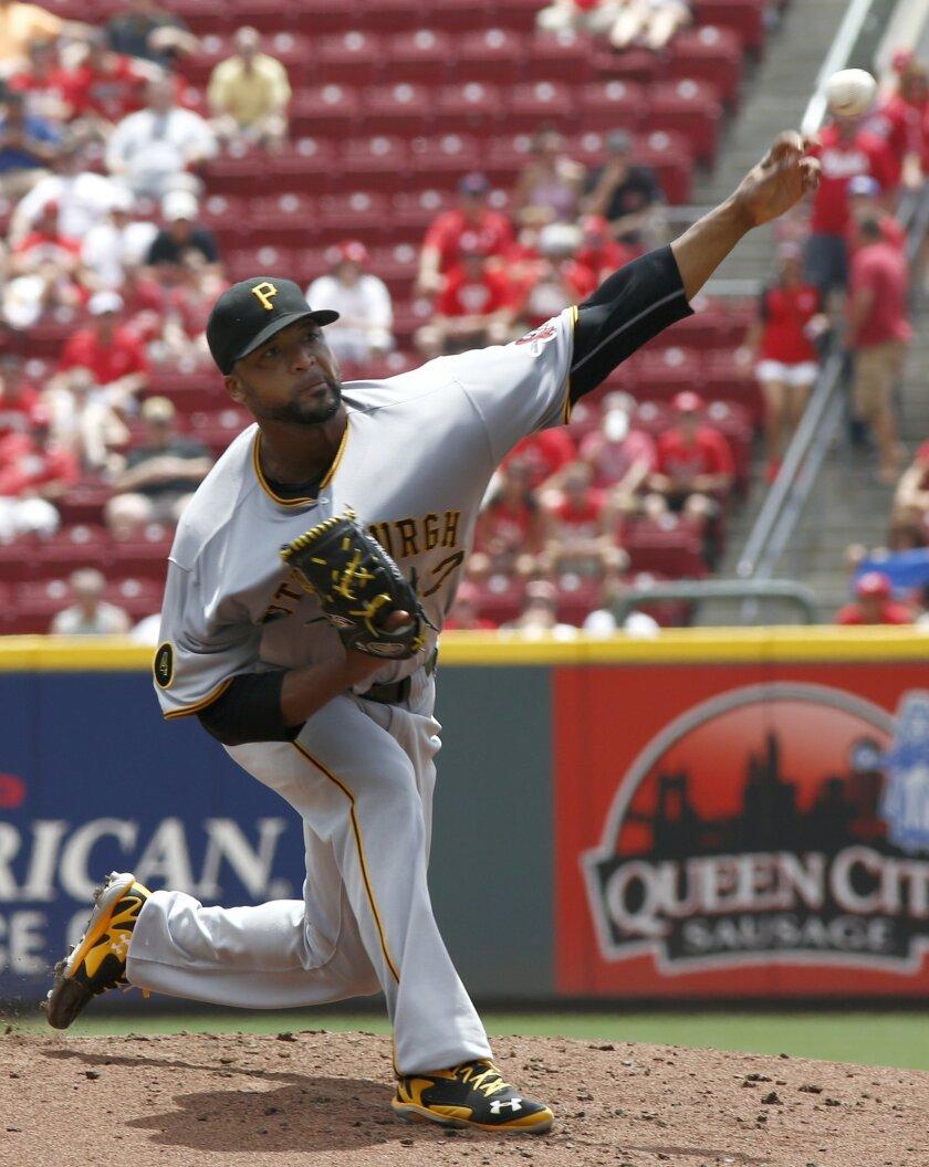 Pittsburgh Pirates starting pitcher Francisco Liriano throws to a Cincinnati Reds batter in the first inning of a baseball game, Sunday, July 13, 2014, in Cincinnati. (AP Photo/David Kohl)