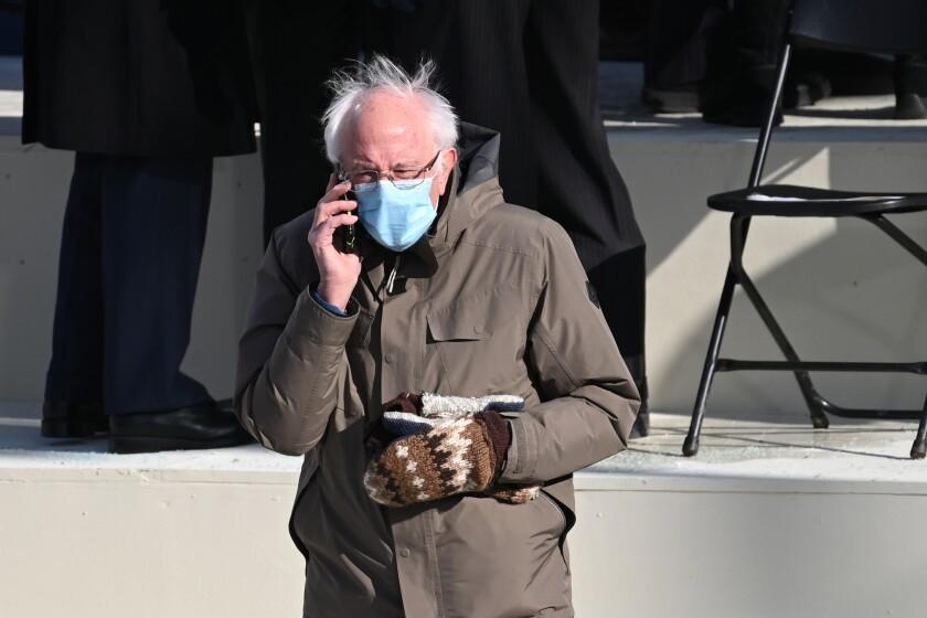 Vermont Senator Bernie Sanders talks on the phone before the inauguration of Joe Biden as the 46th U.S. President.