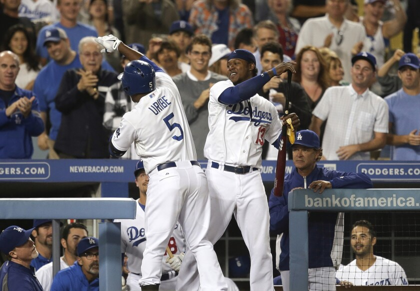 Juan Uribe, left, celebrates his home run with Hanley Ramirez during the Dodgers' 8-1 victory over Arizona.