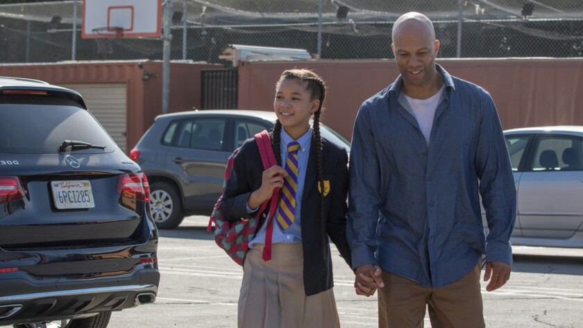 Daniel Crawford walking his daughter to school. People (L to R): Storm Reid (Patricia) and Common (