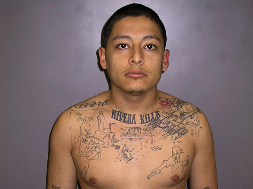 L.A. County Sheriff's detectives said the tattoo on Anthony Garcia's chest included key details from the scene of a liquor store murder that puzzled them for four years.