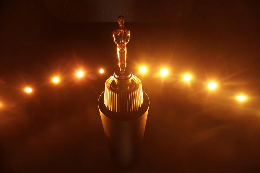 An Oscar rests on a podium