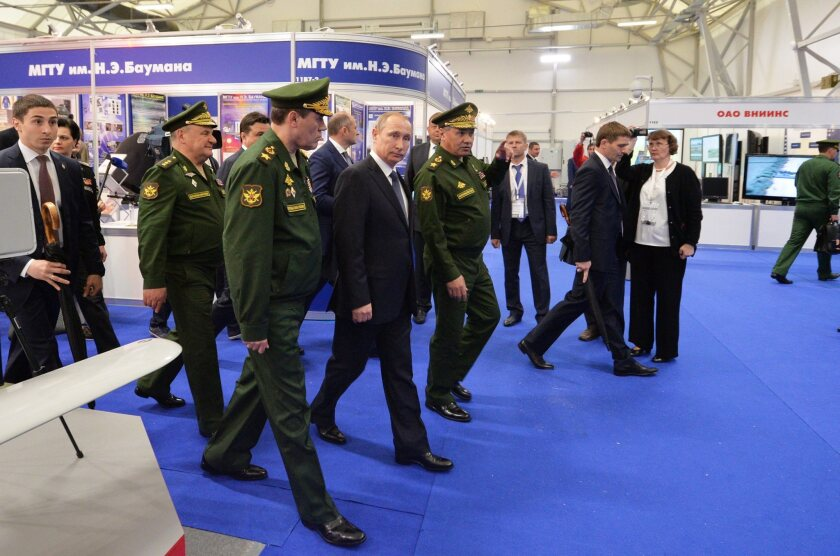 Russian President Vladimir Putin and his top military brass visit an arms show in Kubinka, outside Moscow, on Tuesday.